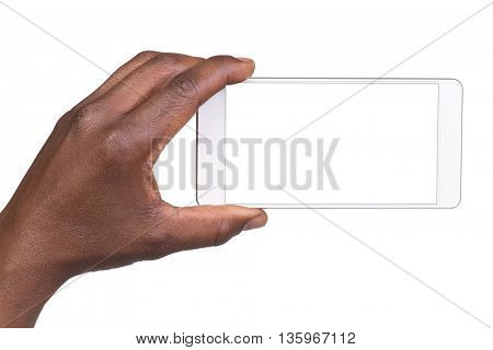 Man holding white mobile smart phone with blank screen. Isolated on white.