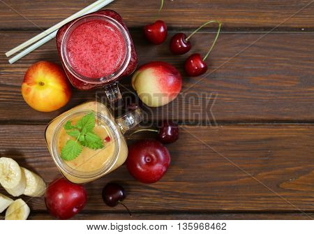 berry fruit drink smoothies with cherries, plums, bananas - healthy food
