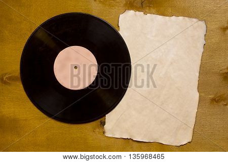Vintage music vinyl records on a wooden table