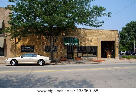 JOLIET, ILLINOIS / UNITED STATES - JUNE 30, 2015: The Moore Glass Company offers repair and installation services for all types of glass, ranging from commercial and home to vehicle needs, in downtown Joliet..