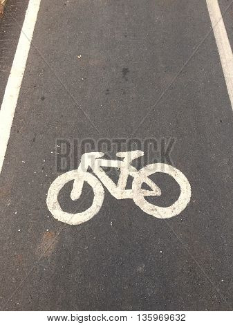 bicycle symbols painted on the road for ridding