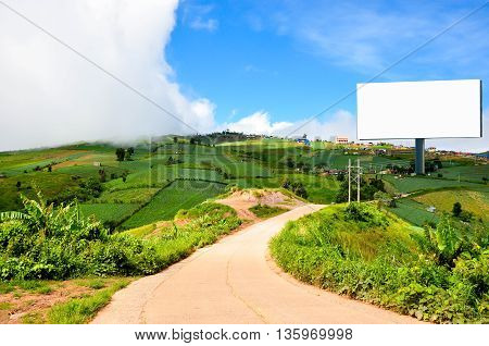 Beautiful countryside landscape with a Blank billboard for advertisement