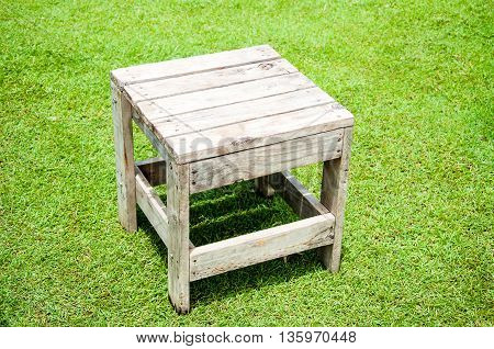 old table on green grass yard in at noon time period.