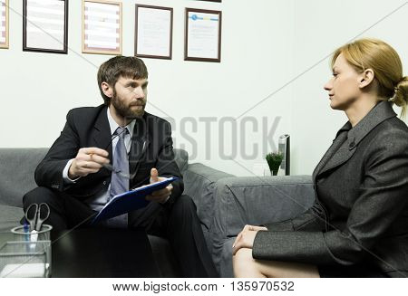 man in a business suit holding a job interview. Ready for interview