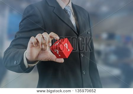 Businessman Hand And Hold Red Cubic With Question Mark