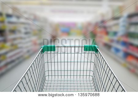 Rear View Of Empty Shopping Cart With Shopping Mall Or Grocery Background
