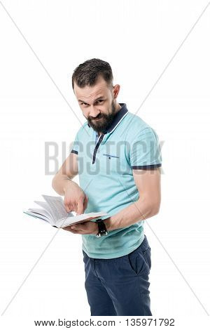 Image of bearded man looks at camera while shows the book