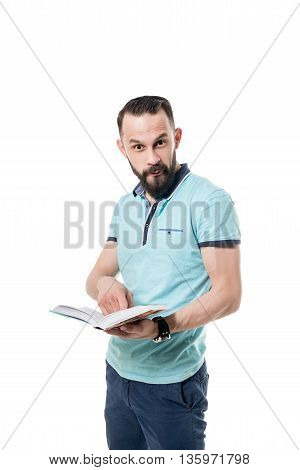 Man makes funny facial expression while reading book