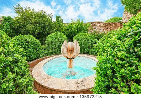 Fountain In The Park Near The Stone Walls Budapest Royal Castle At Day Time. Hungary