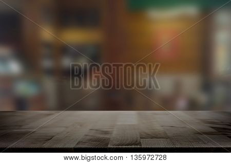 Selected focus empty brown wooden table and space of Coffee shop restaurant blur background with bokeh image for product display montage.
