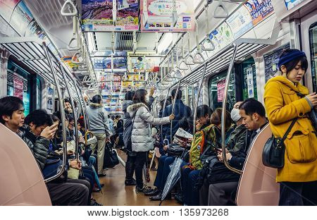 Tokyo Japan - February 26 2015: Tokyo residents travels in subway train