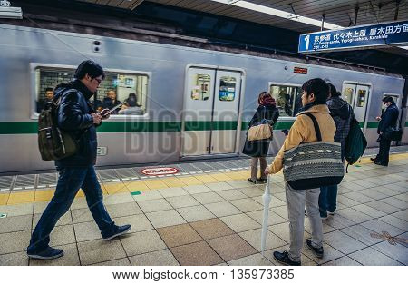 Tokyo Japan - February 26 2015: Passengers waits for a train at the subway station in Tokyo