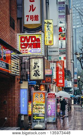 Tokyo Japan - February 26 2015: View on the banners and neon signs on one of the streets in Akasaka district