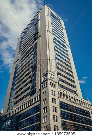 Tokyo Japan - February 27 2015: Modern architecture of Marunouchi dsitrict in Tokyo. View on Otemachi Nomura Building.