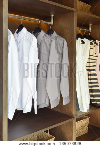 Row Of White And Gray Shirts  Hanging In Wooden Wardrobe