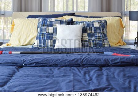 Stylish Bedroom Interior Design With Blue Patterned Pillows On Bed