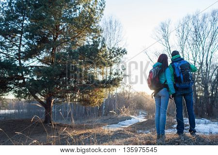 Hiking couple in spring forest. Outdoor adventures concept.