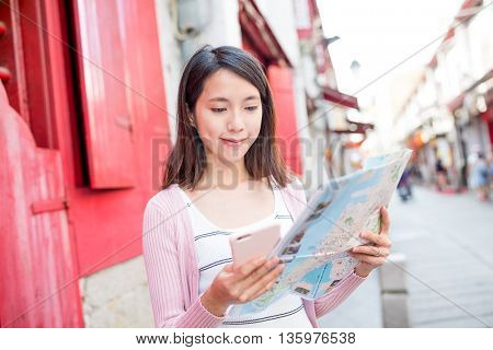 Woman reading on city map in Macau city