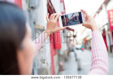 Woman taking photo by cellphone