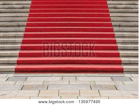 Red carpet on a stairway to mark the route of heads of state vips and celebrities on ceremonial and formal occasions or events