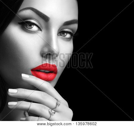 Beauty fashion black and white woman face portrait with perfect makeup and nails isolated on black background. Beauty girl face close up, sexy red lips, perfect skin