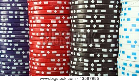 abstract background with casino chips of four different colours