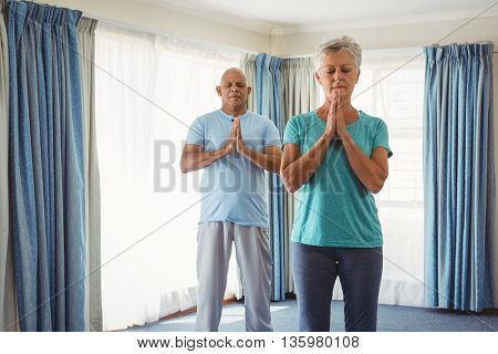 Retired woman and instructor relaxing during fitness class