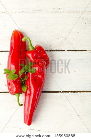 Red peppers lying on a shabby old vintage table