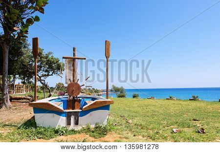 Photo of a sailor boat on a beach in protaras Cyprus island.