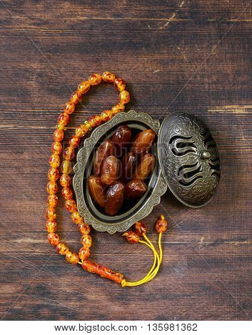 sweet dried dates and amber beads traditional Muslim symbols