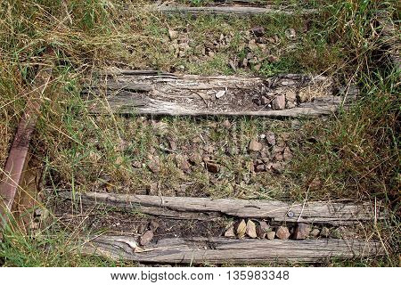 close up of a railway switch abandoned overgrown