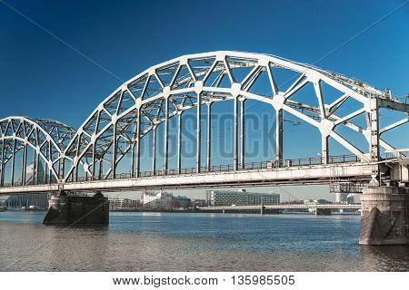 A view of the Railway Bridge over Daugava River in Riga, Latvia at winter