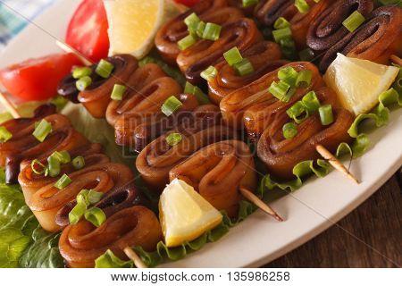 Kebab From Calamari On Skewers With Vegetables Macro. Horizontal