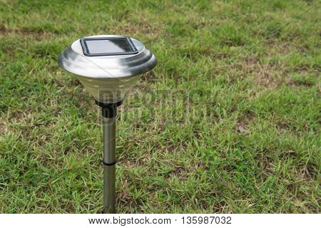 Solar Light in the grass. Clean energy is popular. For Earth, Superfund