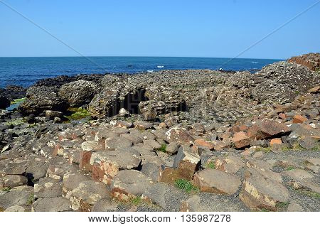 Part Of Giant Causeway With Rocks And See In Ireland