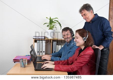 Manager Man Helping Call Centre Agent On A Computer