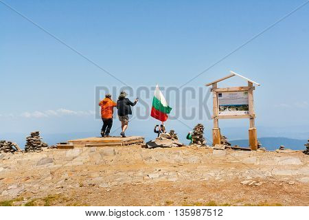 Rila, Bulgaria - June 22, 2016: People taking photo at the peak near Seven Rila Lakes in National Park Rila, Bulgaria