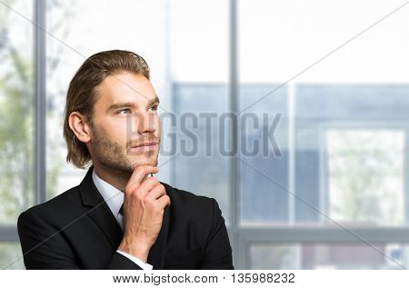 Handsome young businessman in a pensive mood
