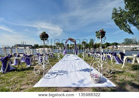Beautiful Wedding Arch And Chairs For Marriage Decorated With Lace Fabric And Flowers. White Decor F