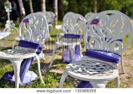 Beautiful Fabric Bow On The Chair. Wedding Restaurant For Marriage. White Decor For Bride And Groom.