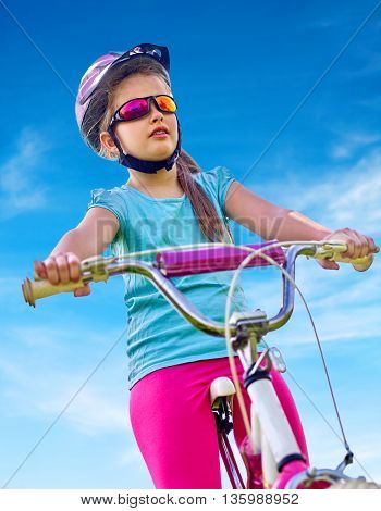 Bikes cycling child. Girl rides bicycle. Little girl in cycling. Cycling is good for child health. Cyclist look away.