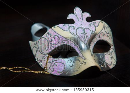 Venetian carnival mask on the black background