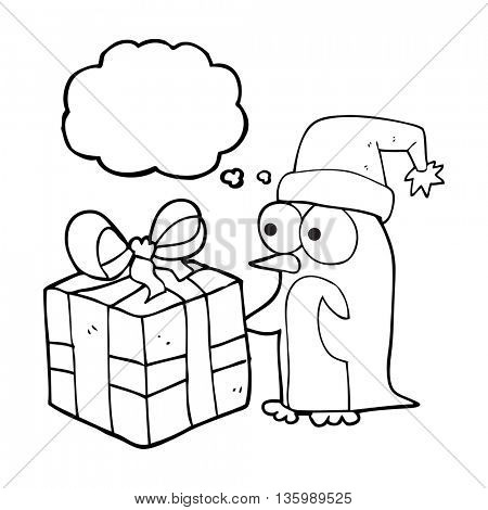 freehand drawn thought bubble cartoon christmas penguin with present
