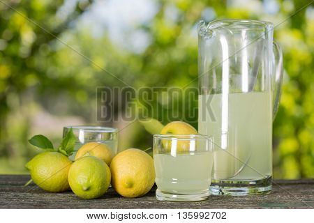 lemon juice on a wooden table, summer set, outdoor