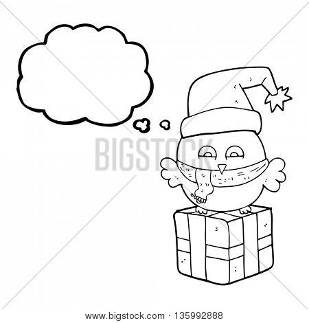 freehand drawn thought bubble cartoon cute christmas owl on wrapped present