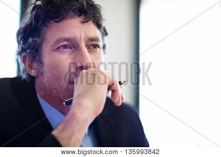 Close-up of thoughtful businessman sitting in restaurant
