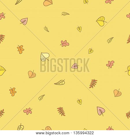 Seamless pattern with falling leaves on  yellow  background. Autumn season. Vector image.