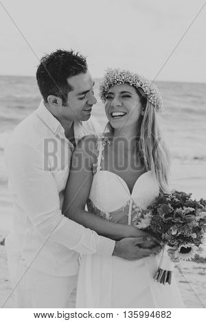 Latin couple celebrating their wedding in the Mayan Riviera, Mexico. (Film look, contains grain)