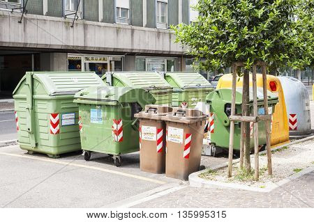 Udine Italy-may 18 2016: area dedicated to bins for separate collection of rubbish.