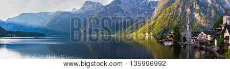 Scenic panoramic picture-postcard view of famous Hallstatt mountain village with Hallstatter See in the Austrian Alps